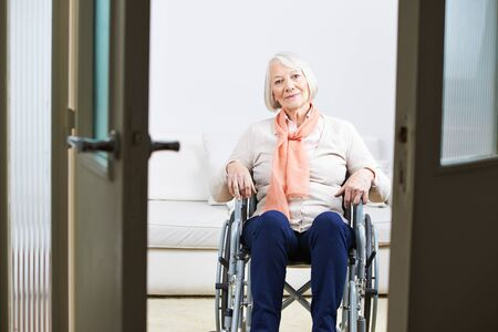 social work aged care: Old woman sitting in a wheelchair at home Stock Photo