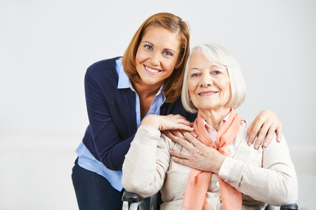 disabled seniors: Happy family with woman and senior woman at home Stock Photo