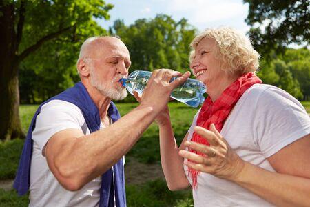 drink water: Happy senior couple drinking fresh water in summer