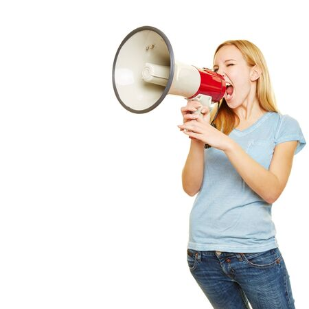 speaking: Young blonde woman shouting loudly with a big megaphone