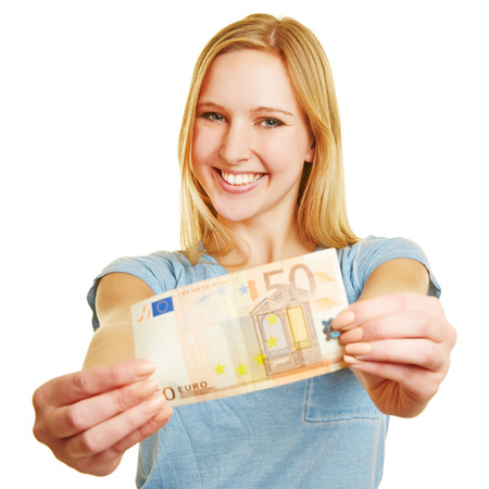 banknote: Happy young woman holding a 50 Euro bill in her hands Stock Photo