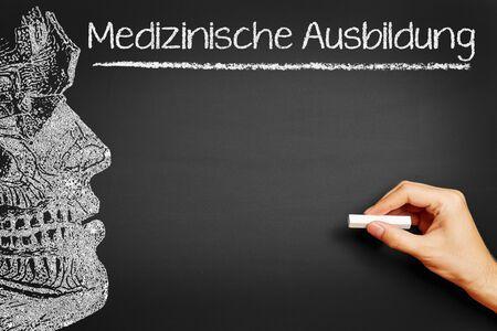 Hand writing in German Medizinische Ausbildung (Medical class) on a blackboard