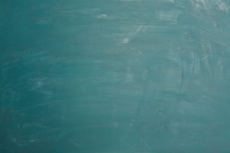 chalkboard: Empty green chalkboard with rests of chalk as background