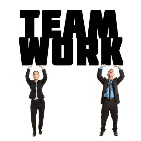 arms above head: Two business people lifting together the word Teamwork Stock Photo