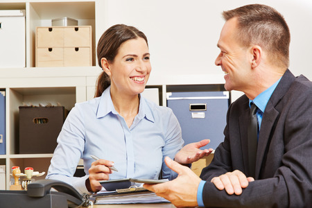 Man during consultation talk with woman for a new insurance