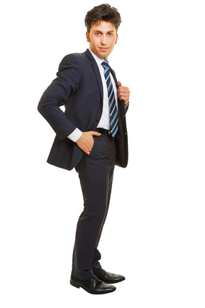 trouser: Business man standing with his hand in his trouser pocket isolated on white