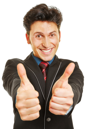 both: Cheering businessman holding both of his thumbs up Stock Photo