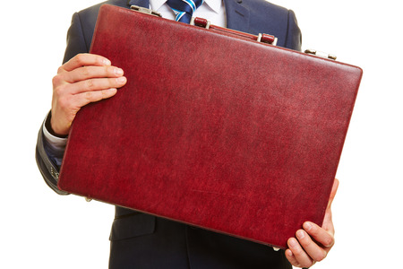 business briefcase: Hands of a business man holding a red leather briefcase