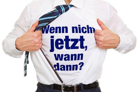 then: Motivation in German for business success as concept on shirt Wenn nicht jetzt, wann dann? (If not now then when?)