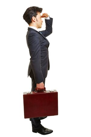businessman suit: Business man with briefcase looking forward for motivation isolated on white
