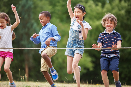 Children arriving to the finish line at a birthday party Stock Photo