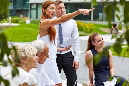 successful woman: Successful woman taking leadershop for business team and showing directions Stock Photo