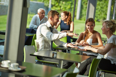 Business team having consultation at table in a canteen