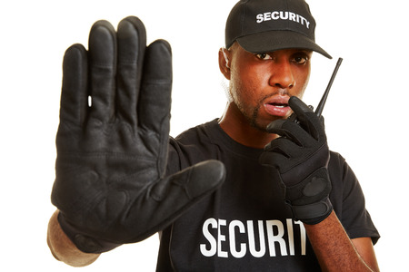 service man: Man from security firm talking into radio set and keeping distance with his hand Stock Photo