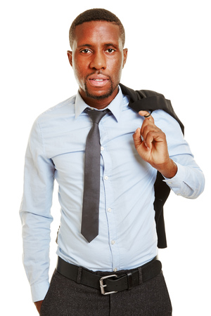 african business man: African business man carrying his jacket over the shoulder