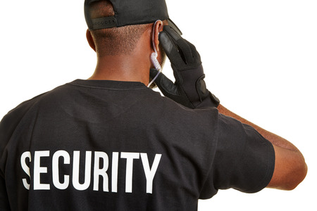 sense of security: Black man as security guard from behind