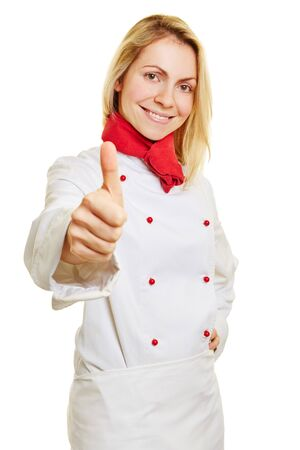 Female happy chef cook holding her thumbs up