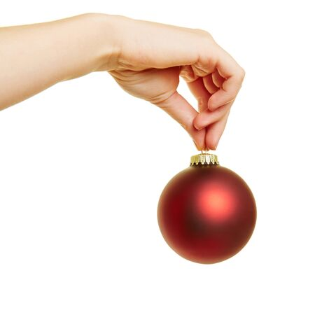 christmas tree ball: Female hand holding a red christmas tree ball for christmas