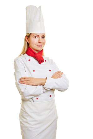 apprenticeship: Woman as chef cook in apprenticeship with chefs head and workwear Stock Photo
