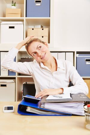 tense: Young business woman in office stretching her tense nape with her hand