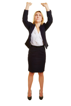 imaginary: Young woman lifting heavy imaginary object over her head Stock Photo
