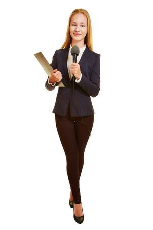 tv reporter: Full body shot of woman as TV reporter with microphone Stock Photo