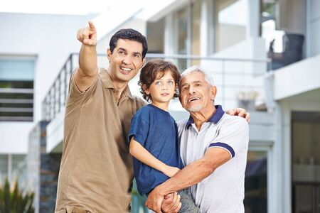 generation: Father of family with son and grandfather showing future goal