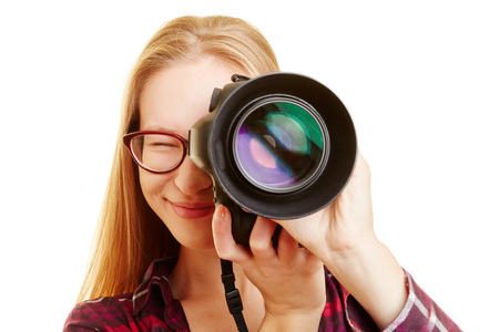 stock photography: Smiling young woman with professional camera taking pictures Stock Photo