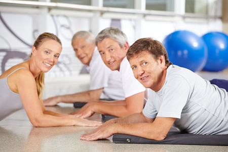 Woman as instructor for senior sport in a fitness center