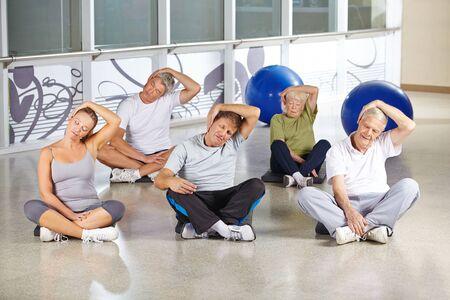 Senior people loosing nape during back training in gym photo