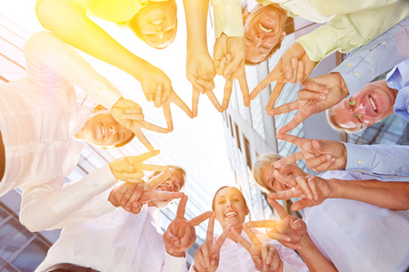Friendship and solidarity with hands of business people forming a star shape Stock Photo