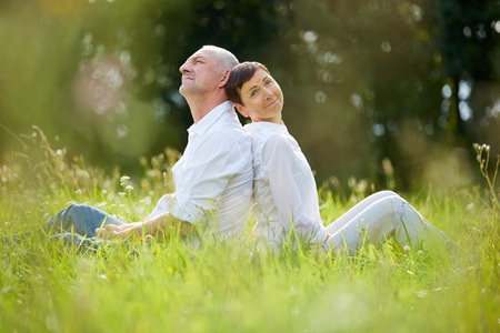 old people: Senior couple relaxing in nature in summer Stock Photo