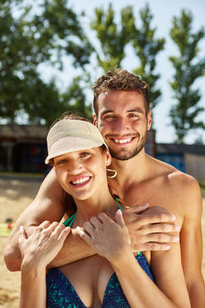 young happy couple: Happy couple on their summer holidays ath the beach