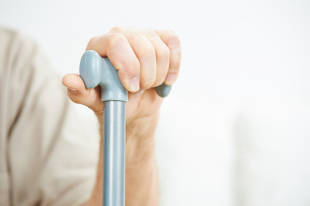 home care: Hand of senior man holding on to a cane