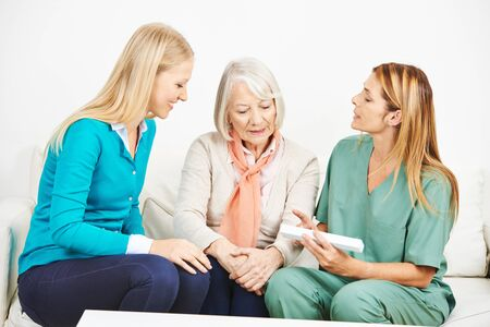 dosage: Nurse explaining medicine dosage for senior woman at home