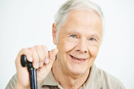 walking stick: Smiling old man with his hand on a cane Stock Photo