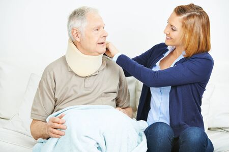 ruff: Nursing service checking ruff of senior man in nursing home Stock Photo