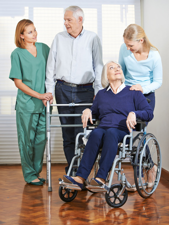 social work aged care: Woman doing elderly care with senior couple at home Stock Photo