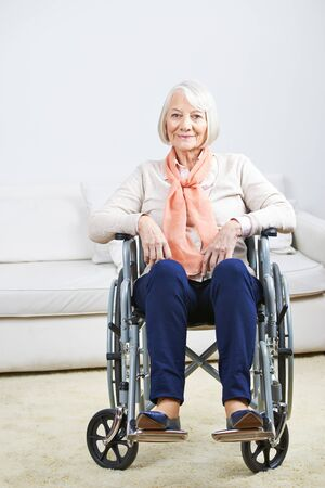 social work aged care: Smiling old senior woman in wheelchair at home