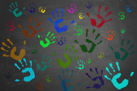 painted hands: Many colorful painted hands printed on a blackboard