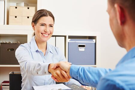 sucessful: Two sucessful business partner shaking hands in the office