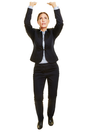Isolated full body business woman lifting heavy imaginary object