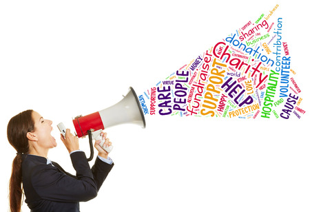 speaking tube: Business woman calling for charity fundraiser with a megaphone Stock Photo