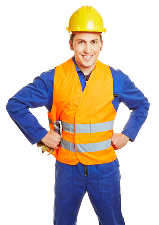 hardhat: Smiling construction worker with hardhat and safety vest and protective gloves