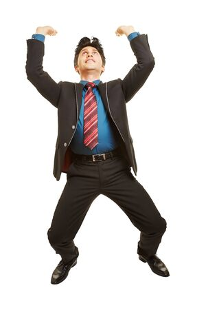 invisible object: Businessman raising heavy invisible object over his head Stock Photo