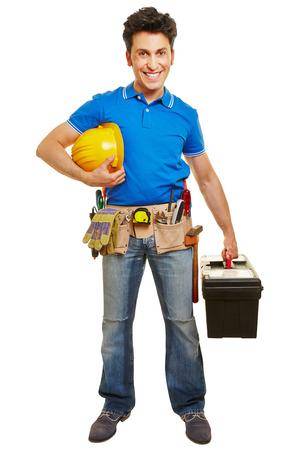 tool belt: Smiling worker with hardhat and tool belt and toolbox