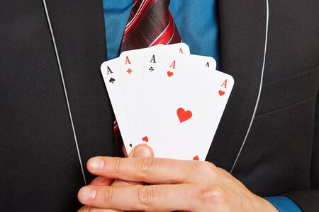 aces: Business man holding four aces cards in his hands