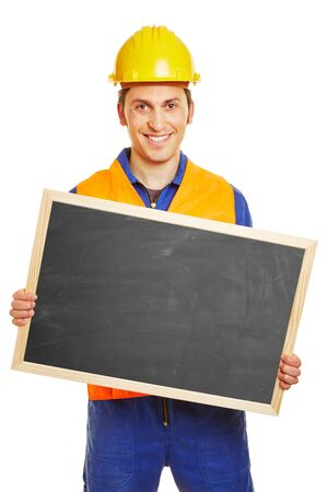 blue collar: Smiling blue collar worker holding an empty blackboard Stock Photo