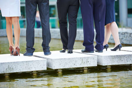 team from behind: Legs and pants of many business people from behind Stock Photo
