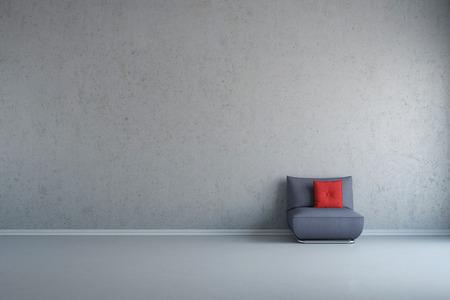 Grijze stoel met rode cusie voor betonnen muur met kopie ruimte Stockfoto